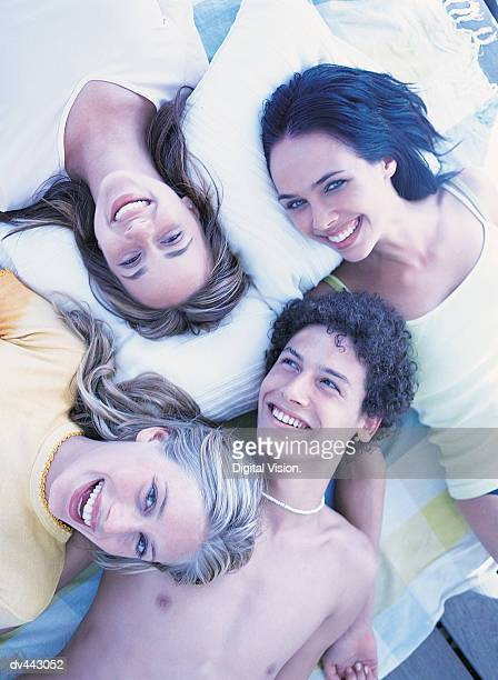 Four friends lying together