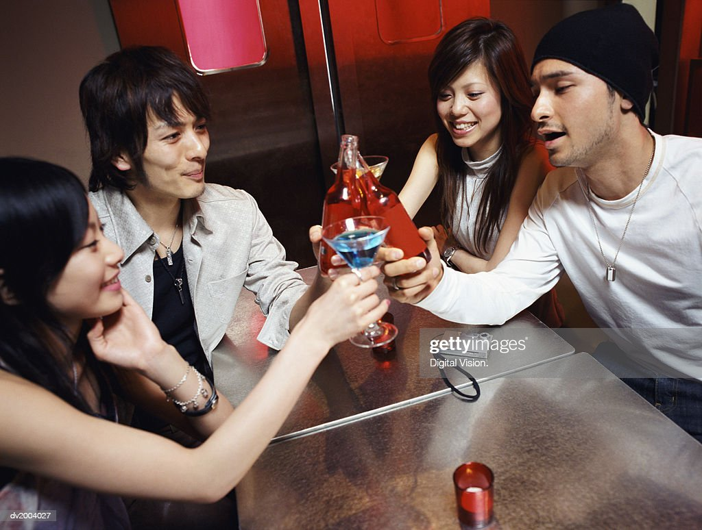 Four Friends making a Toast With Cocktails : Stock Photo