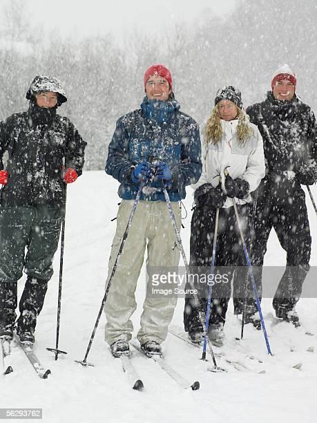 four friends on skis - wasserform stock-fotos und bilder