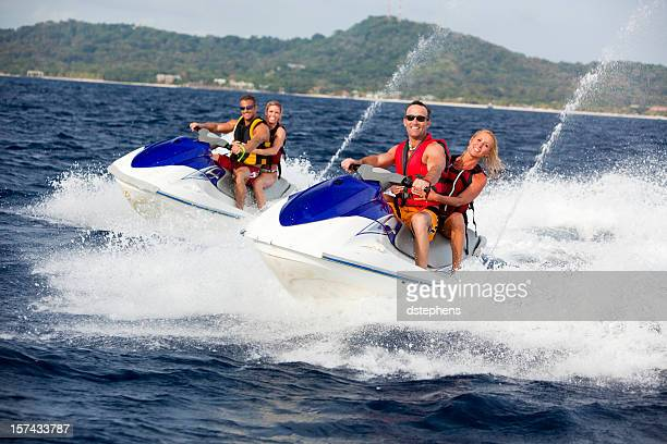 Four Friends ridding jetski personal watercraft