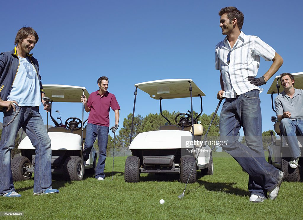 Four Friends Standing Together on a Golf Course : Stock Photo