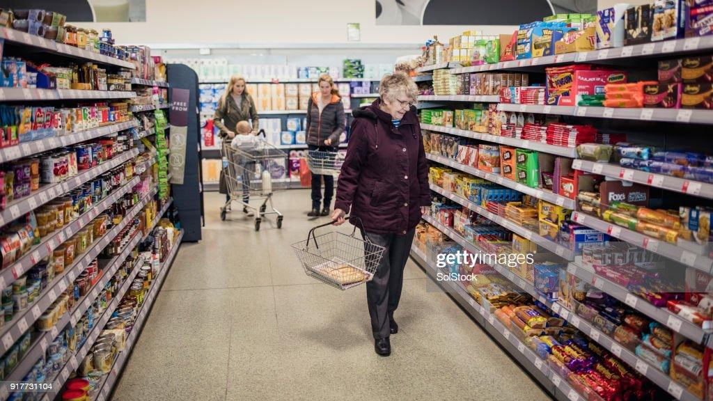 Four Generation Family Shopping : Stock Photo