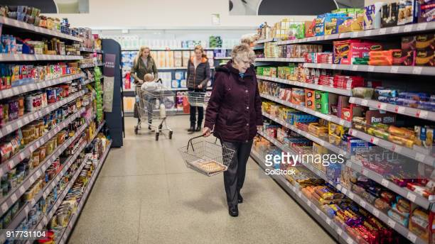 four generation family shopping - british granny stock photos and pictures
