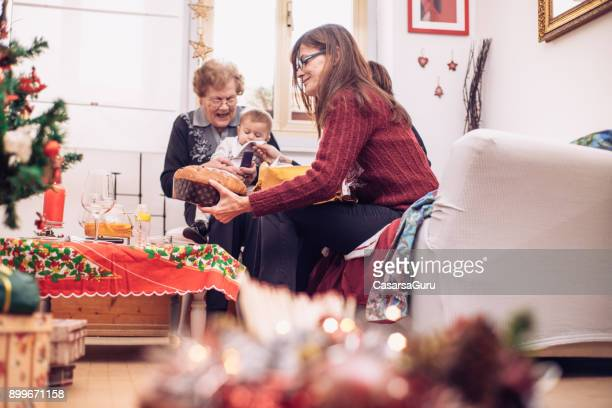 four generation women celebrating christmas together - great grandmother stock pictures, royalty-free photos & images