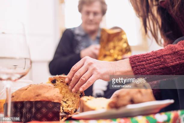 four generation women celebrating christmas together - panettone foto e immagini stock