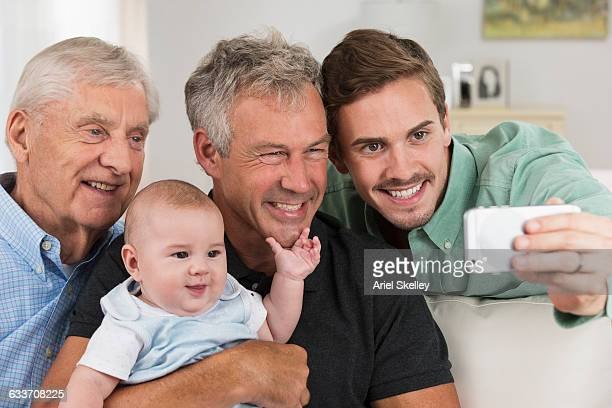 Four generations of Caucasian men taking selfie