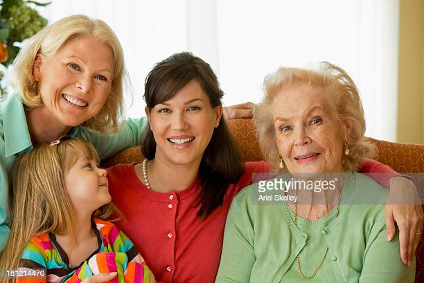 four generations of caucasian women smiling - great granddaughter stock photos and pictures