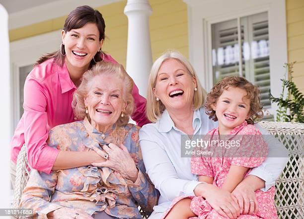 Four generations of Caucasian women smiling