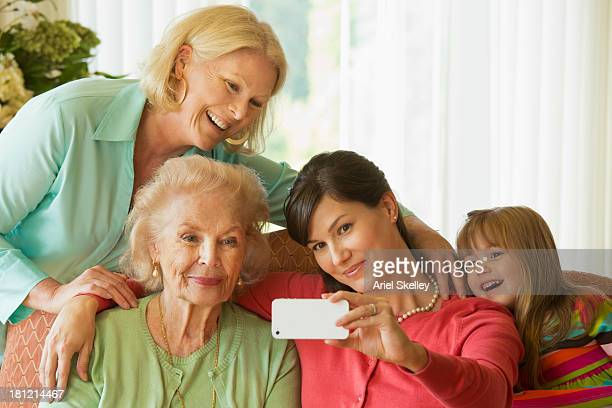 Four generations of Caucasian women taking picture