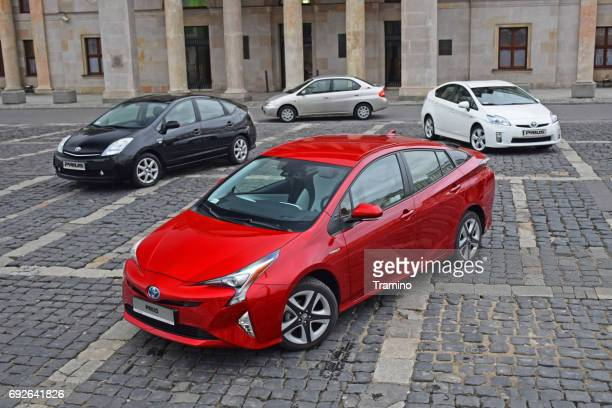 four generations of toyota prius vehicles - hybrid car stock photos and pictures