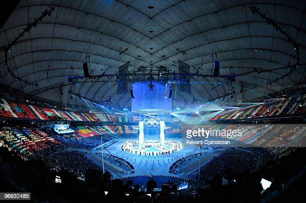 Four giant totems are at the center of the stage during the Opening Ceremony of the 2010 Vancouver Winter Olympics at BC Place on February 12, 2010...