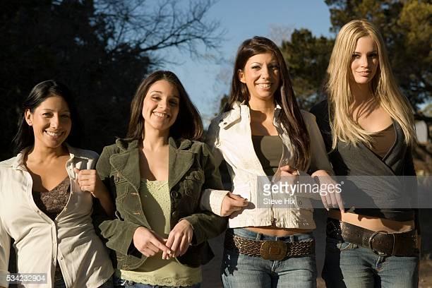 Four Girlfriends Walking Arm in Arm