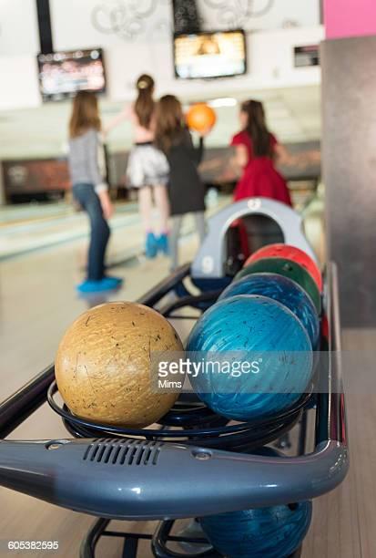 Four girls bowling