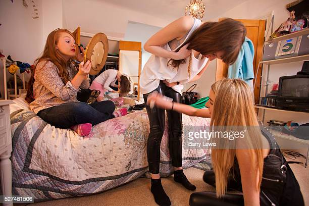 Four girls getting ready for an 18th birtday party for Julia Cummings and Rebecca Stone in the bedroom of Julia's sister Katy The girls names are...