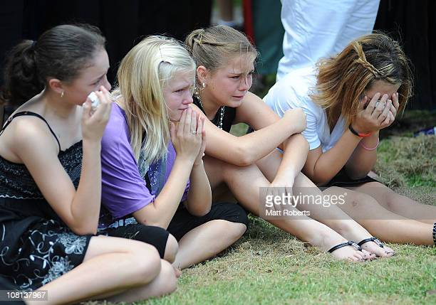 Four girls mourn at the funeral of mother and son killed in last week's flash floods on January 19 2011 in Toowoomba Australia Donna Maree Rice 43...