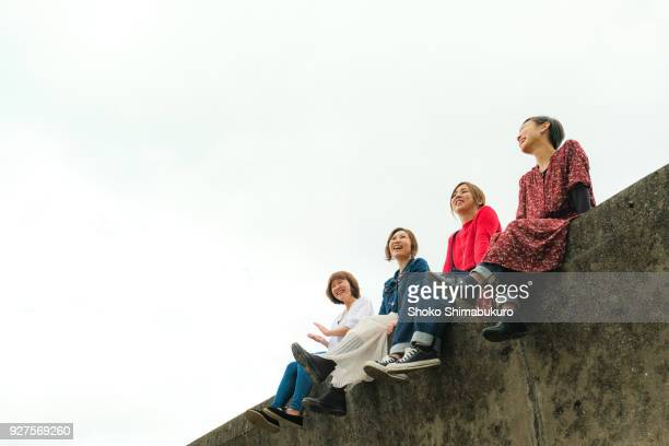 Four girls playing in nature