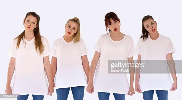 four girls side by side wearing white t-shirts - vier personen stock-fotos und bilder