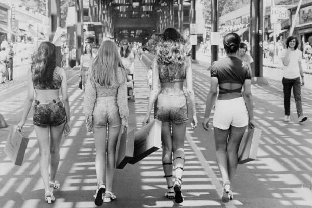 Four girls walking down White Plains Road during Promenade F