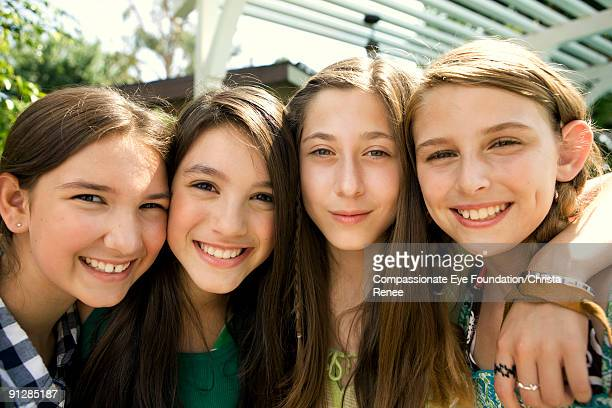 Four girls with arms around each other