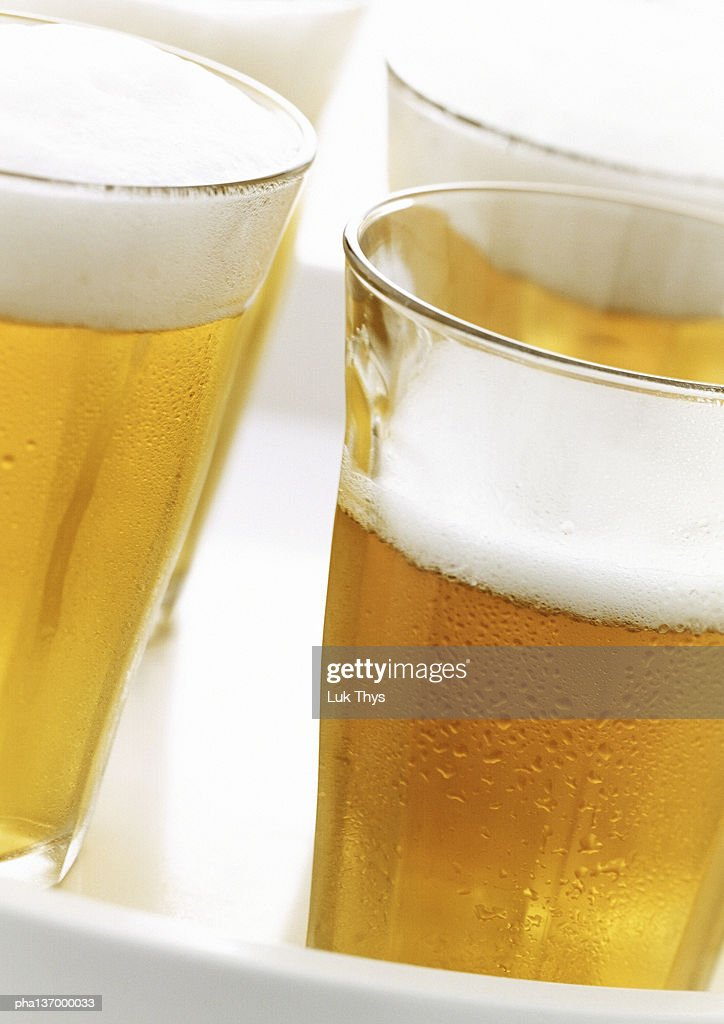 Four glasses of beer. : Stockfoto