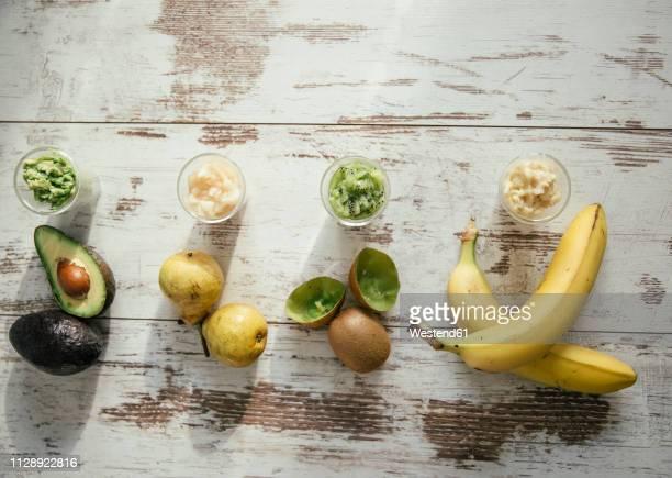 four glasses of various fruit mush - 果肉 ストックフォトと画像