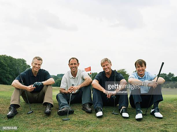 four golfers - four people stock pictures, royalty-free photos & images