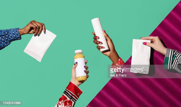 four hands holding blank products - packaging stock pictures, royalty-free photos & images