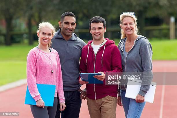 Four Happy Gym Coaches
