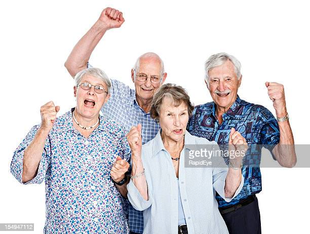 Four happy seniors cheering and waving clenched fists