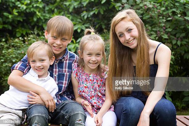 Four happy siblings outdoors