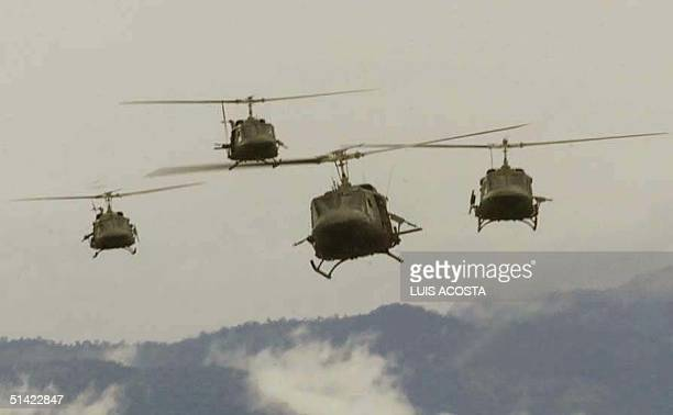 Four helicopters UH1N of the anti-narcotics battalion, given by the USA, maneuvers in the military base of Larandia 04 May 2001 in the province of...