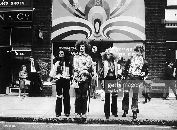 Four hippies cross a road in London watched with disapproval by passersby 1967