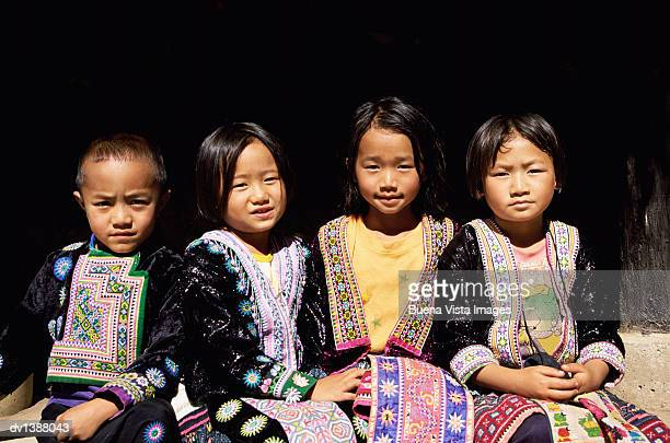 Four Hmong Children in Traditional Clothing, Chiang Rai, Thailand