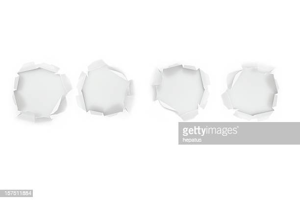 Four hole in a white paper