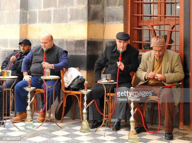CONTENT] Four hookah smokers sitting outside in Damascus Syria