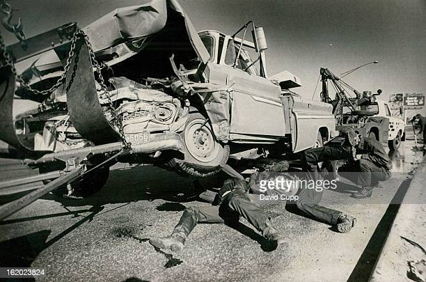 OCT 7 1974 Four Injured in Threevehicle crash A vehicle is ready to be towed away Monday following a j threevehicle accident that injured four...