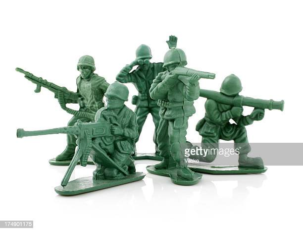 Four isolated toy soldiers on a white background