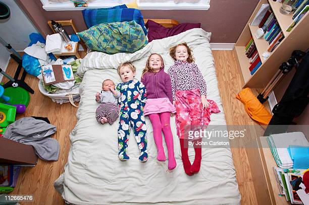 Four kids on bed