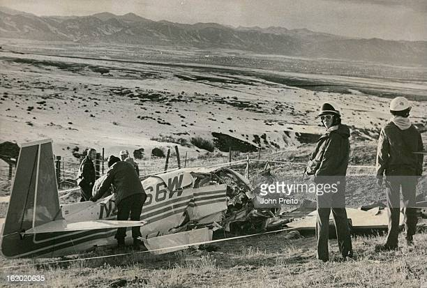 FEB 11 1979 Four Killed in Crash Rescue workers look over the wreckage of a singleengine plane tile crashed on Phipps Highlands Ranch south of...