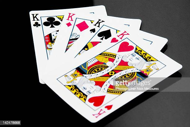 Four king playing cards