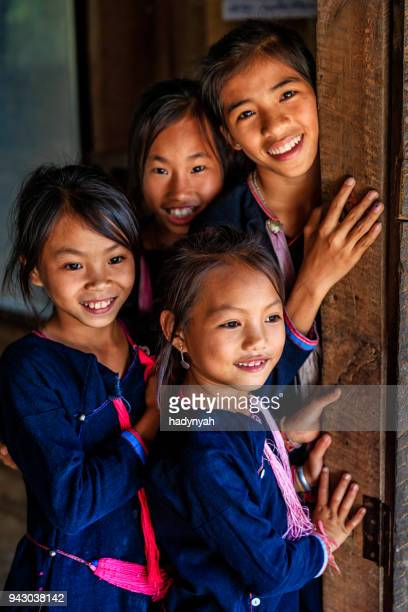 Four Laotian young girls in a primary school, village in Northern Laos