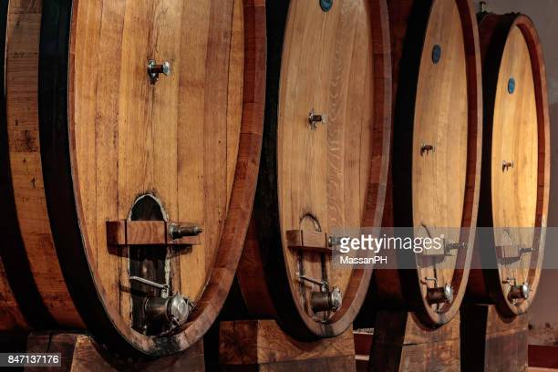 Four large oak casks in a wine cellar