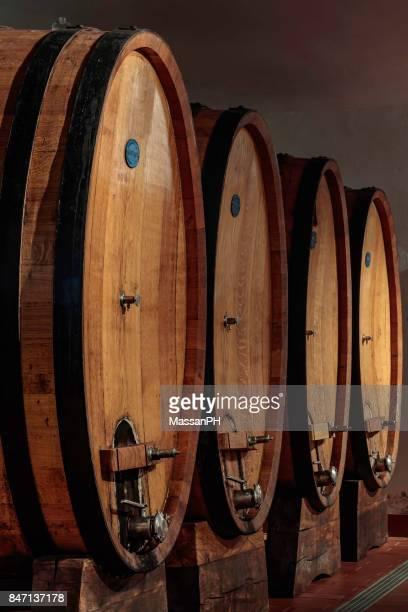 Four large oak casks in a wine cellar