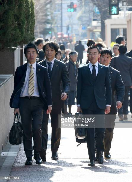 Four lawyers representing investors in Japanese exchange firm Coincheck enter the Tokyo District Court in Tokyo on February 15 2018 Cryptocurrency...