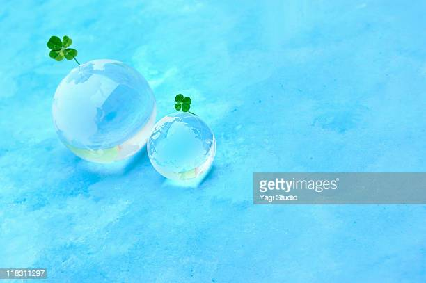 Four leaf clover and a glass globe