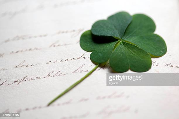 Four Leaf Clover on Antique writing