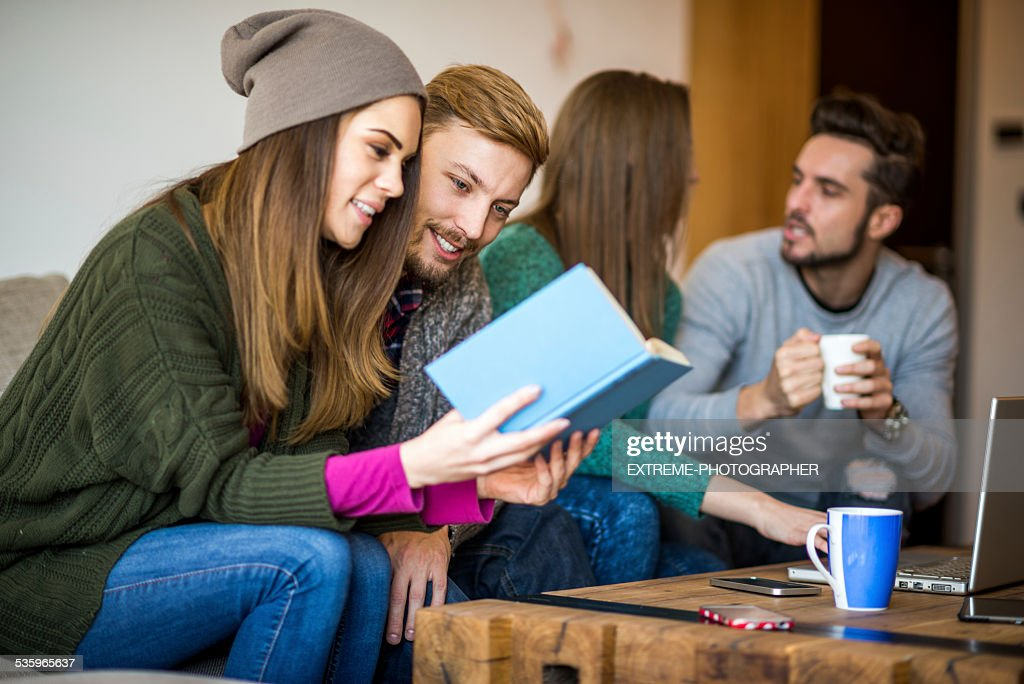 Four learning students : Stock Photo