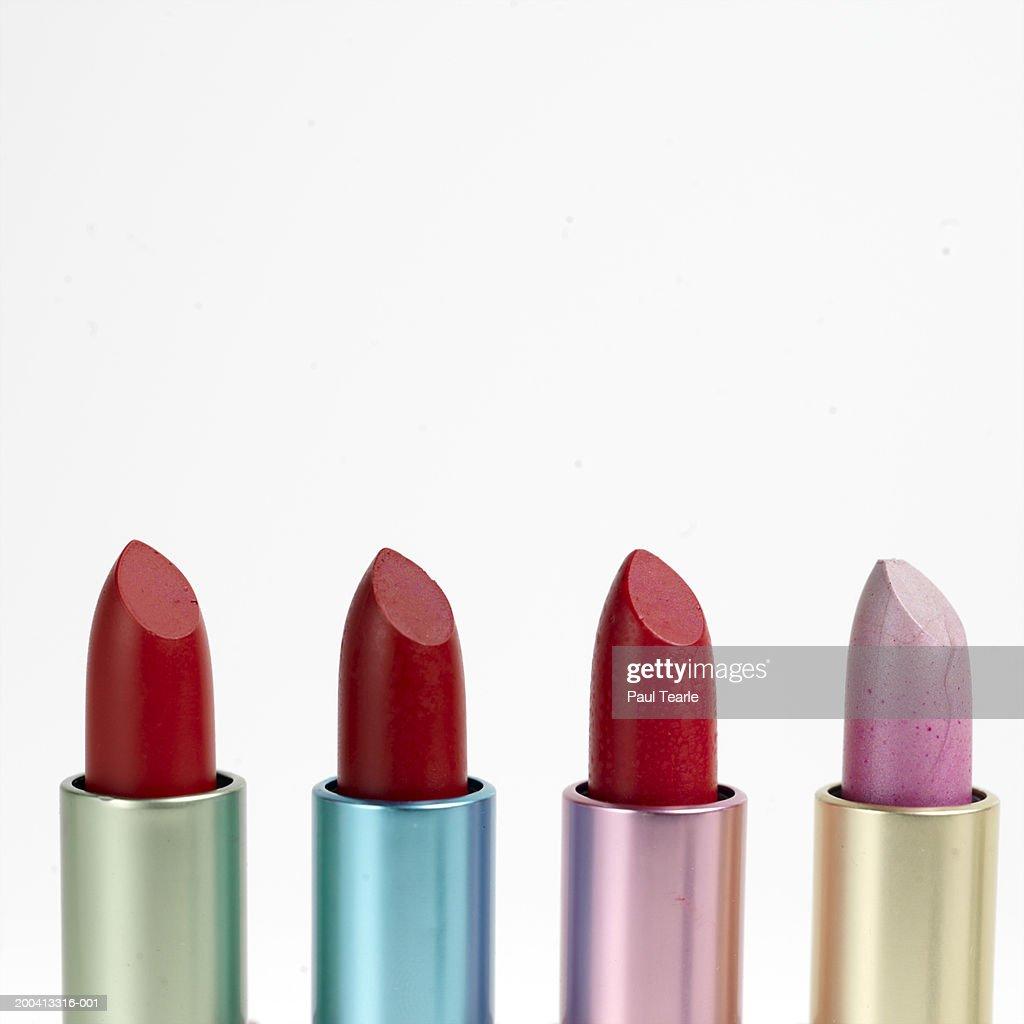 Four lipsticks, close up : Stock Photo