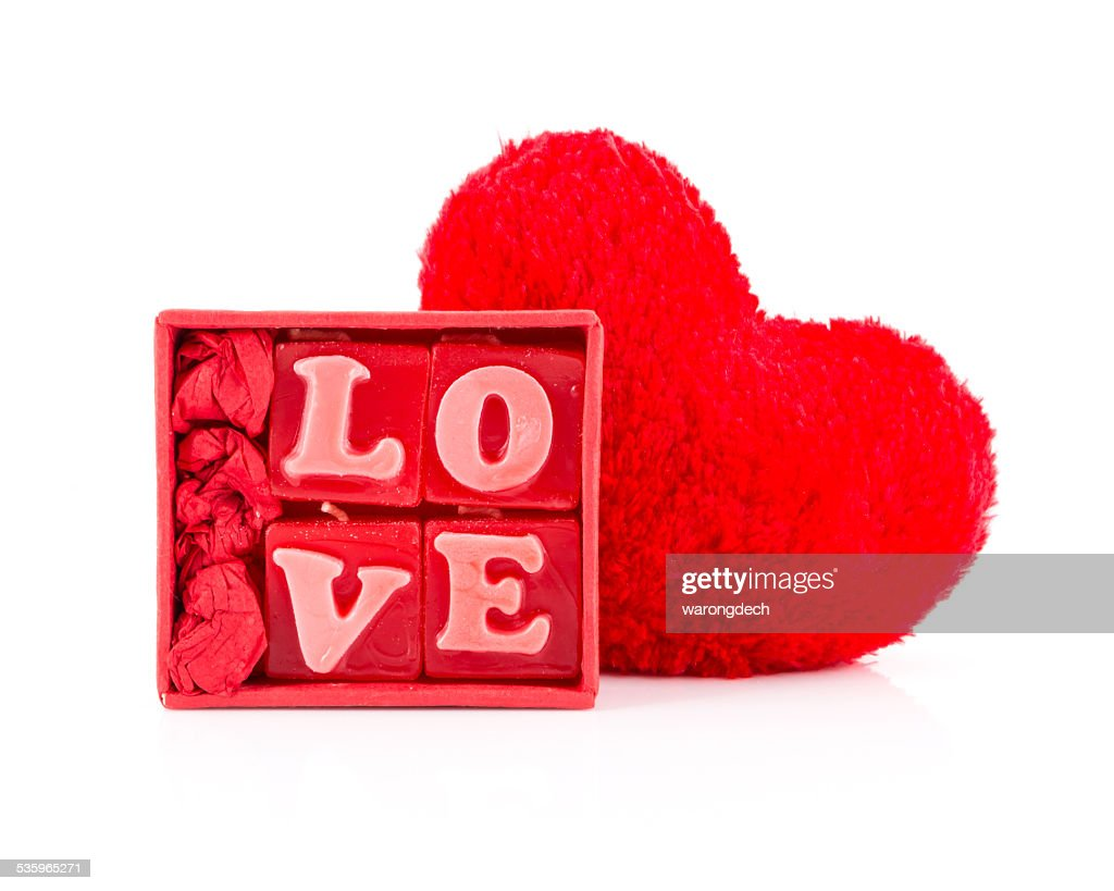 Four little candles making the word 'love' : Stock Photo