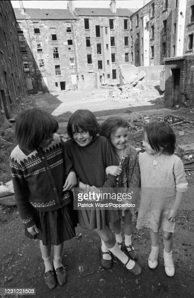 Four little girls posing in front of slum housing in the notorious Gorbals district of Glasgow in 1969. These tenement buildings have since been...